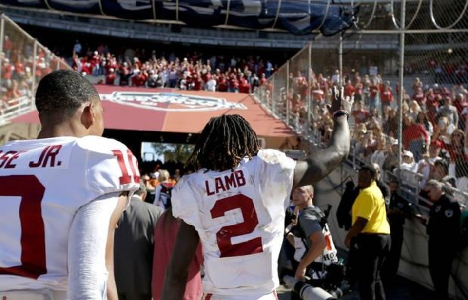 Photo -  Oklahoma receiver CeeDee Lamb waves to fans after the Sooners' 34-27 win Saturday over Texas in the Cotton Bowl. Lamb was awarded the Walter Camp National Offensive Player of the Week honor on Sunday. [Sarah Phipps/The Oklahoman]
