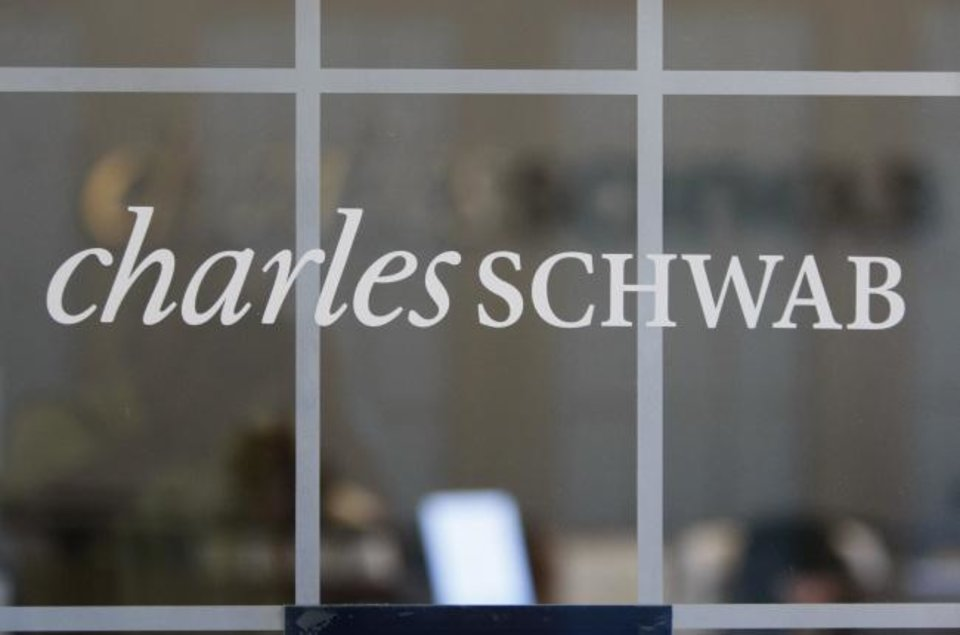 Photo -  A Charles Schwab office is shown in Oakland, Calif. [AP PHOTO]