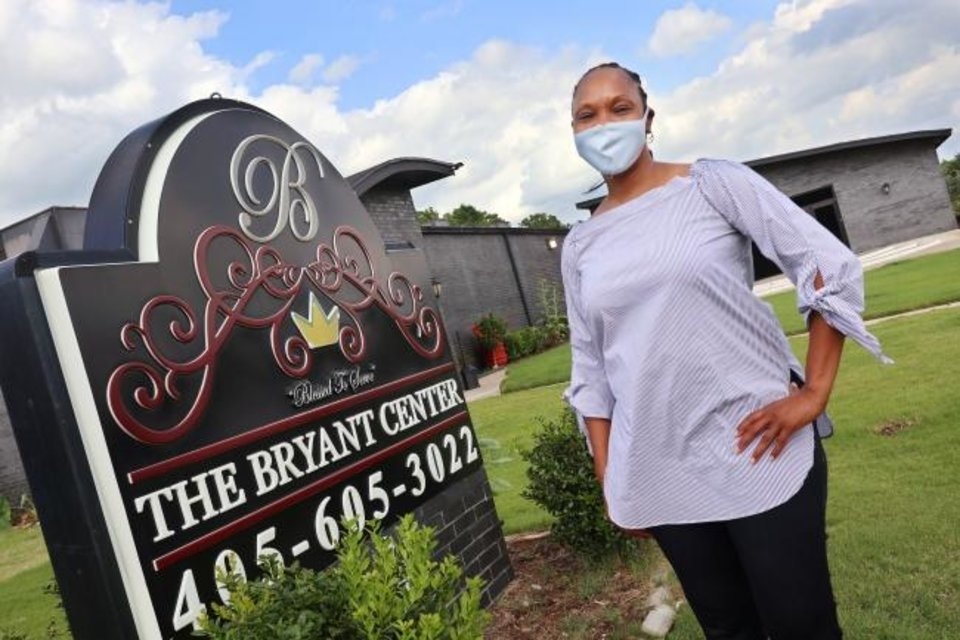 Photo -  Caterer Demetra Bailey kept her business open with meals ordered by BancFirst for its employees. [DOUG HOKE/THE OKLAHOMAN]