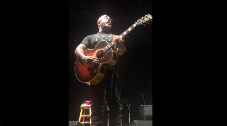 Photo -  Aaron Lewis addresses the audience during a recent concert in Oklahoma City. [IMAGE VIA YOUTUBE]