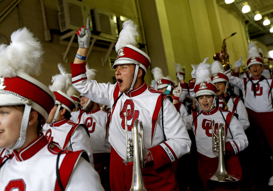 Photo - Members of the Pride of Oklahoma enter the stadium before the Red River Showdown college football game between the University of Oklahoma Sooners (OU) and the University of Texas Longhorns (UT) at the Cottonbowl in Dallas on Saturday, Oct. 11, 2014. 