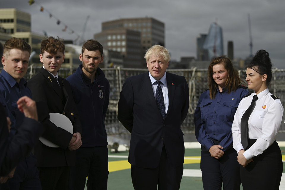 Photo -  Britain's Prime Minister Boris Johnson speaks to apprentices as he visits the NLV Pharos, a lighthouse tender moored on the river Thames, to mark London International Shipping Week in London, Thursday, Sept. 12, 2019. The British government insisted Thursday that its forecast of food and medicine shortages, gridlock at ports and riots in the streets after a no-deal Brexit is an avoidable worst-case scenario, as Prime Minister Boris Johnson denied misleading Queen Elizabeth II about his reasons for suspending Parliament just weeks before the country is due to leave the European Union. (Daniel Leal-Olivas/Pool photo via AP)