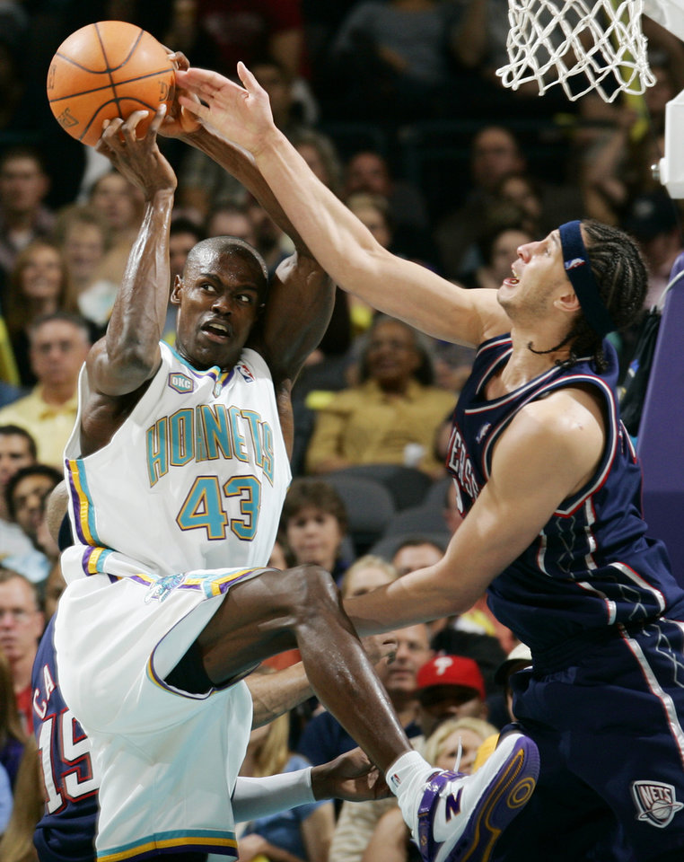 Photo - Hornet Linton Johnson (43) grabs a rebound next to Josh Boone (2) of New Jersey during the NBA basketball game between the New Orleans/Oklahoma City Hornets and the New Jersey Nets at the Ford Center in Oklahoma City, Tuesday, March 13, 2007. The Nets won, 112-108. By Nate Billings, The Oklahoman  ORG XMIT: KOD