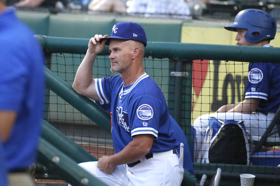 Photo -  Manager Travis Barbary watches the team play during the Oklahoma City Dodgers game against the New Orleans Baby Cakes June 25, 2019. [Paxson Haws/The Oklahoman]
