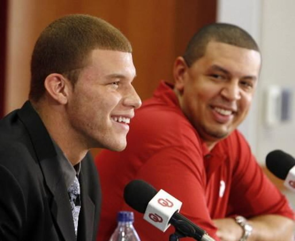 Photo - University of Oklahoma college basketball star Blake Griffin announces he will leave the Sooner team for the NBA professional draft in Norman, Okla. on Tuesday, April 7, 2009. At right is head coach Jeff Capel. Photo by Steve Sisney, The Oklahoman