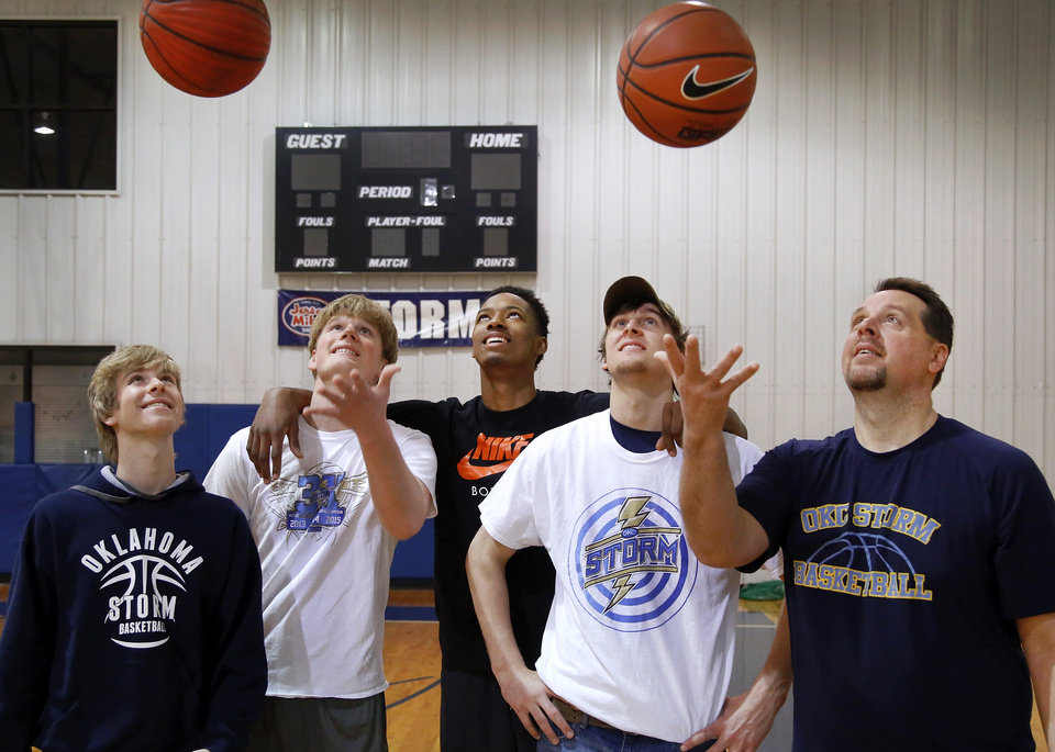 Photo - (for Jenni's column)  From left, basketball players Tanner Fike, Mark Malone, Tevin Townsend, Kole Talbott and Coach Kurt Talbott pose for a photograph in the gym at the Church of the Harvest in northeast Oklahoma City on Monday, March 16, 2015. Oklahoma City Storm homeschool basketball team won another national title over the weekend. But it was what they did at the end of their blowout victory in the title game that has folks buzzing. The Storm enabled a disabled player from the opposing team to get to the free throw line and score a couple points. They Photo by Jim Beckel, The Oklahoman
