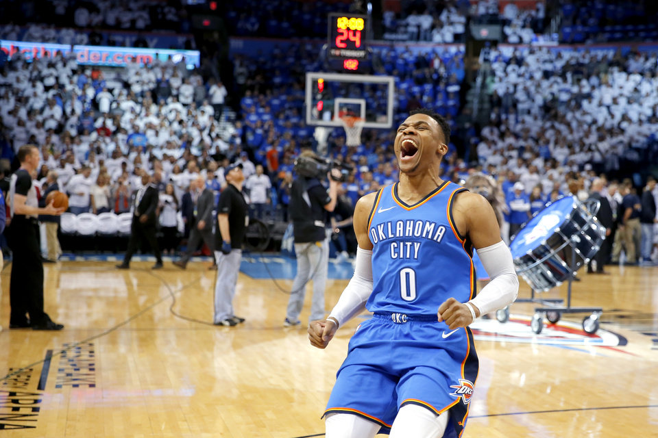 Photo - Oklahoma City's Russell Westbrook (0) shouts towards the crowd before the start of Game 5 of the first round NBA playoff series between the Oklahoma City Thunder and the Utah Jazz at Chesapeake Energy Arena in Oklahoma City, Wednesday, April 25, 2018. OKC Thunder won 107-99.  Photo by Bryan Terry, The Oklahoman
