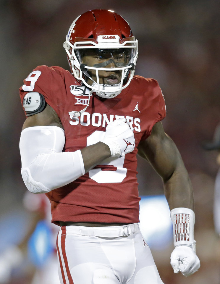 Photo - Oklahoma's Kenneth Murray (9) celebrates a defensive play in the first quarter during an NCAA football game between the University of Oklahoma Sooners (OU) and the TCU Horned Frogs at Gaylord Family-Oklahoma Memorial Stadium in Norman, Okla., Saturday, Nov. 23, 2019. [Sarah Phipps/The Oklahoman]