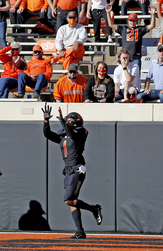 Photo -  Oklahoma State's Landon Wolf (1) catches a touchdown pass in the first quarter between the Cowboys and the Texas Longhorns at Boone Pickens Stadium in Stillwater, Okla., Saturday, Oct. 31, 2020. Wolf announced on Twitter on Monday his decision to leave as a graduate transfer. [Sarah Phipps, The Oklahoman]