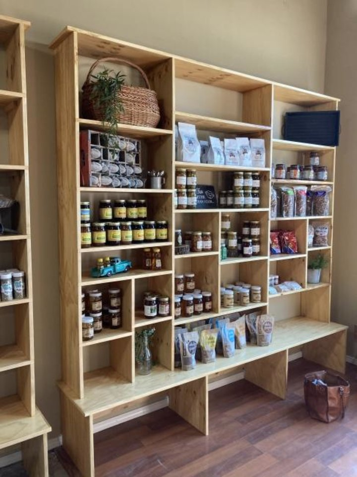 Photo -  The shelves are filling up at the Arcadia Farmers Market General Store, scheduled to open Friday. [KIMBERLY BURK]
