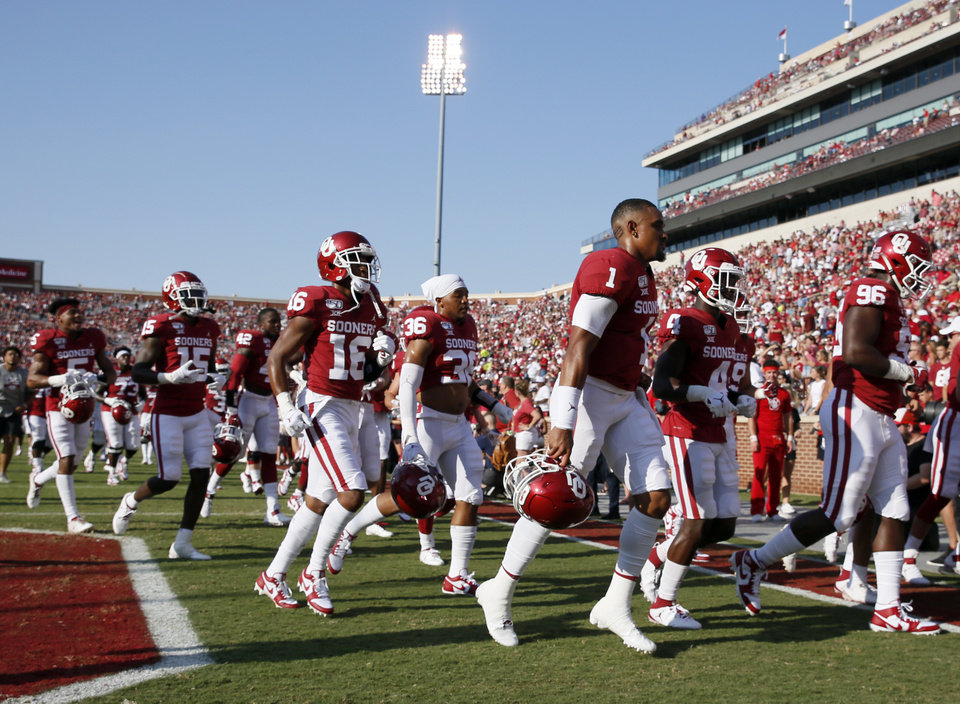 Photo - Oklahoma quarterback Jalen Hurts (1) and the Sooners leave the field after warming up before a college football game between the Oklahoma Sooners (OU) and South Dakota Coyotes at Gaylord Family - Oklahoma Memorial Stadium in Norman, Okla., Saturday, Sept. 7, 2019. [Nate Billings/The Oklahoman]