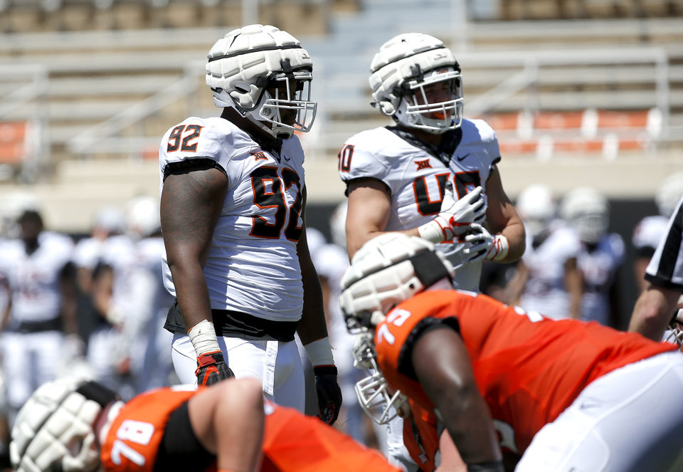 Photo - Oklahoma State's Cameron Murray (92) and Brock Martin (40) prepare to line up during the Oklahoma State Cowboys spring practice at Boone Pickens Stadium in Stillwater, Okla., Saturday, April 20, 2019.  Photo by Sarah Phipps, The Oklahoman