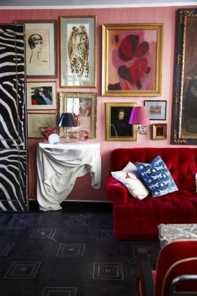 Photo -  A gallery wall in the home of designer Miles Redd in New York City. [PAUL COSTELLO]