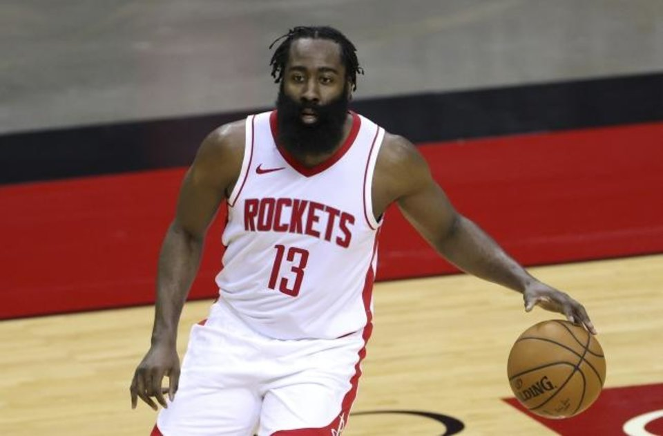 Photo -  The NBA fined James Harden $50,000 and determined he wasn't able to play in Wednesday's game against Oklahoma City. Had the game not been postponed, he would have forfeited $573,000. His four-day quarantine ends Friday, and he should be available for Saturday's game against Portland as long as he returns negative COVID-19 tests. [Carmen Mandato/Pool Photo via AP]