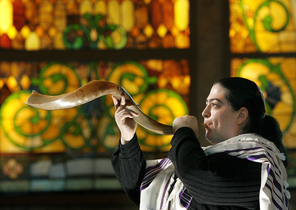 Photo - FEMALE / WOMAN: Rabbi Abby Jacobson  is new rabbi at Emanuel Synagogue in Oklahoma City,  Friday,  Sept. 11, 2009.  She is photographed blowing the shofar,  in conjunction with the observance of Rosh Hashana, the Jewish New Year. Photo by Jim Beckel, The Oklahoman ORG XMIT: KOD