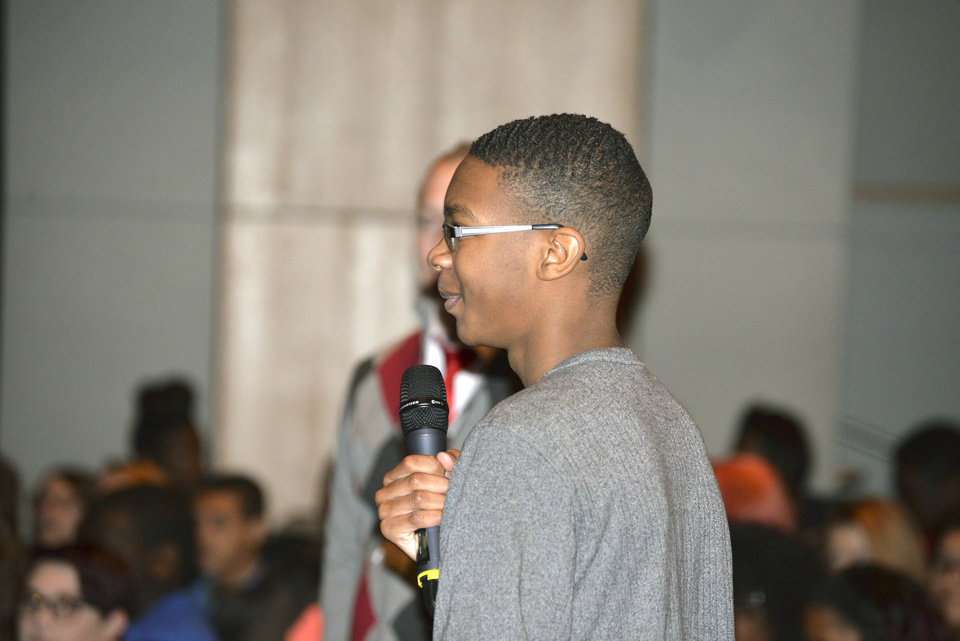 Photo -  Anthony Hairston, a student at Carl Albert High School, asks a question during a Monday assembly about pioneer civil rights workers in Oklahoma. [Photo by Stacey Boyer, For The Oklahoman]