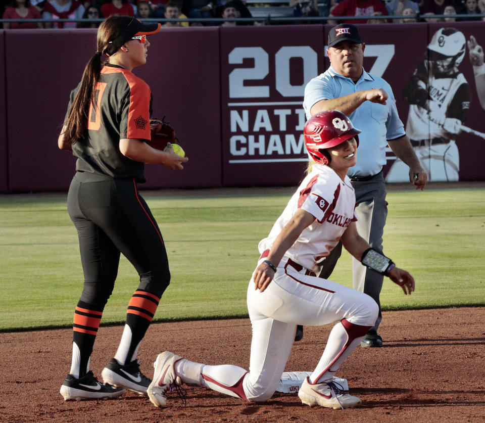 Photo - Sooner Sydney Romero is out at second loosing a race back to the bag as Madi Sue Montgomery makes the out in Bedlam softball as the University of Oklahoma Sooners (OU) play the Oklahoma State Cowboys (OSU) at Marita Hynes Field at the OU Softball Complex on  May 4, 2019 in Norman, Okla.  [Steve Sisney/For The Oklahoman]