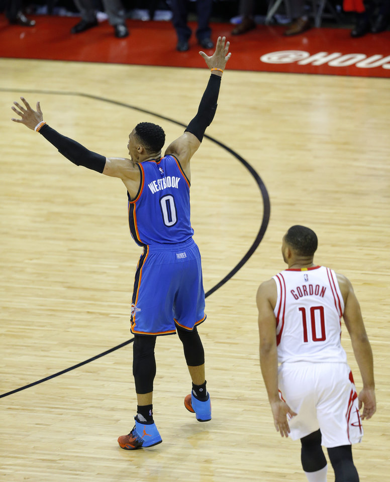 Photo - Russell Westbrook (0) argues for a foul in front o fHouston's Eric Gordon (10) during Game 2 in the first round of the NBA playoffs between the Oklahoma City Thunder and the Houston Rockets in Houston, Texas,  Wednesday, April 19, 2017.  Photo by Sarah Phipps, The Oklahoman