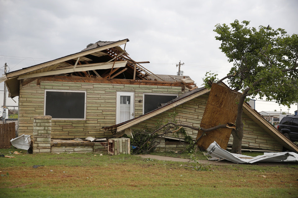 Photo - Tornado damage to a home along State Highway 66 in El Reno, Okla., Sunday, May 26, 2019. [Bryan Terry/The Oklahoman]
