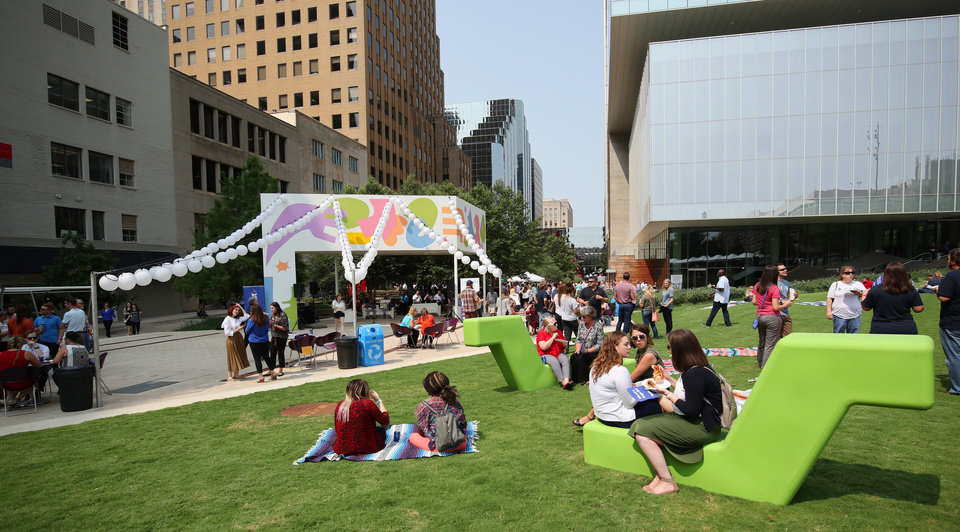 Photo -  Crowds gathered during lunchtime Tuesday celebrate the makeover of Kerr Park, which was refurbished with movable seating, covered tables, lights and a pavilion. [Photos by Doug Hoke, The Oklahoman]