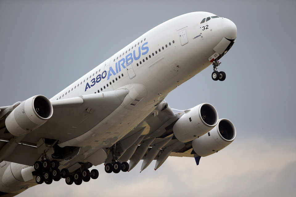Photo -  FILE - In this June 18, 2015, file photo, an Airbus A380 takes off for its demonstration flight at the Paris Air Show in Le Bourget airport, north of Paris. European plane maker Airbus lost 1.1 billion euros ($1.3 billion) amid an unprecedented global slump in air travel because of the pandemic, but expects to deliver hundreds of planes and make a profit this year. (AP Photo/Francois Mori, File)