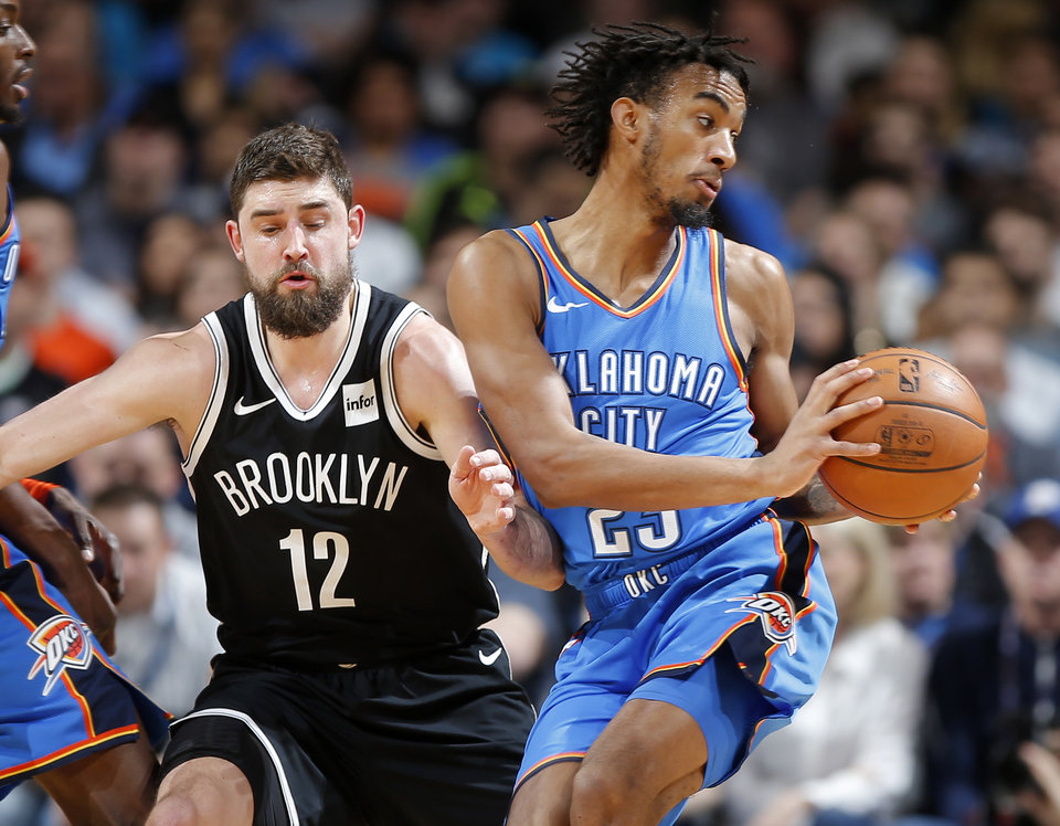 Photo - Oklahoma City's Terrance Ferguson (23) goes past Brooklyn's Joe Harris (12) during an NBA basketball game between the Oklahoma City Thunder and the Brooklyn Nets at Chesapeake Energy Arena in Oklahoma City, Wednesday, March 13, 2019. Photo by Bryan Terry, The Oklahoman
