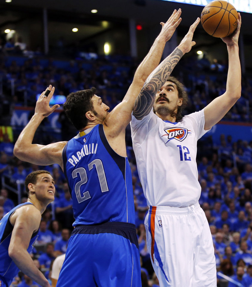 d624a56d5ef Oklahoma City s Steven Adams (12) shoots against Dallas  Zaza Pachulia (27)  during Game 5 of the first round series between the Oklahoma City Thunder  and ...