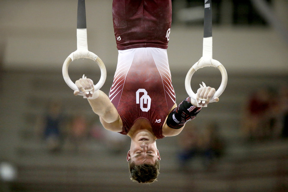 Photo - Oklahoma's Hunter Justus competes on the rings during a gymnastics meet with Illinois at McCasland Field House in Norman, Okla., Saturday, March 18, 2017. Photo by Bryan Terry, The Oklahoman