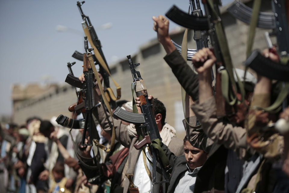 Photo - Tribesmen loyal to Houthi rebels, hold their weapons as they chant slogans during a gathering aimed at mobilizing more fighters into battlefronts in several Yemeni cities, in Sanaa, Yemen, Sunday, Oct. 2, 2016. (AP Photo/Hani Mohammed)