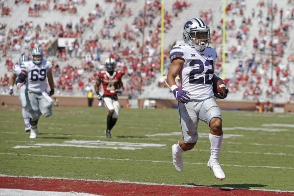 Photo -  Kansas State's Deuce Vaughn (22) scores a touchdown during a 38-35 win Saturday at Oklahoma. [Bryan Terry/The Oklahoman]