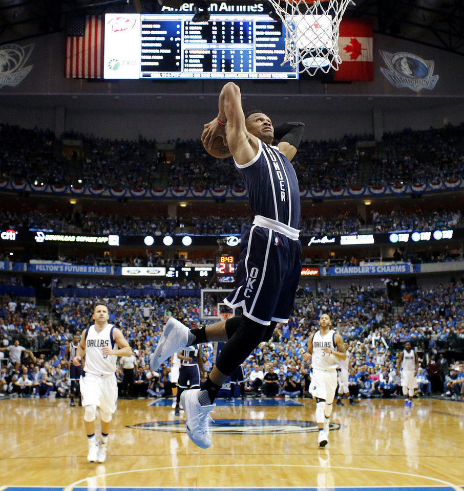 Photo - Oklahoma City's Russell Westbrook (0) goes up for a dunk during Game 3 of the first round series between the Oklahoma City Thunder and the Dallas Mavericks in the NBA playoffs at American Airlines Center in Dallas, Thursday, April 21, 2016. The Thunder won 131-102. Photo by Bryan Terry, The Oklahoman