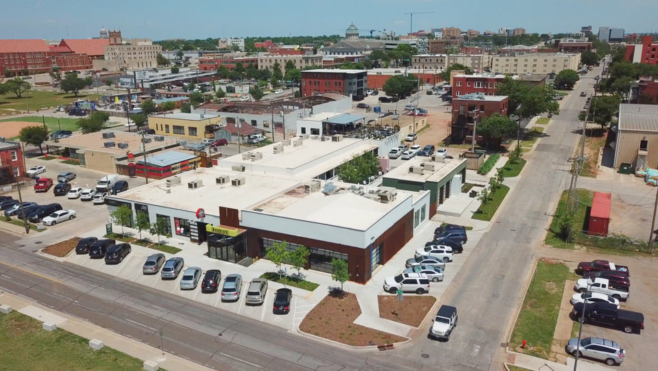 Photo -  The former Swanson's Tire Shop at NW 9 and Hudson Avenue, shown in this aerial view looking northeast, has been redeveloped into a mix of restaurants, shops and offices. [Photo by David Morris, The Oklahoman]