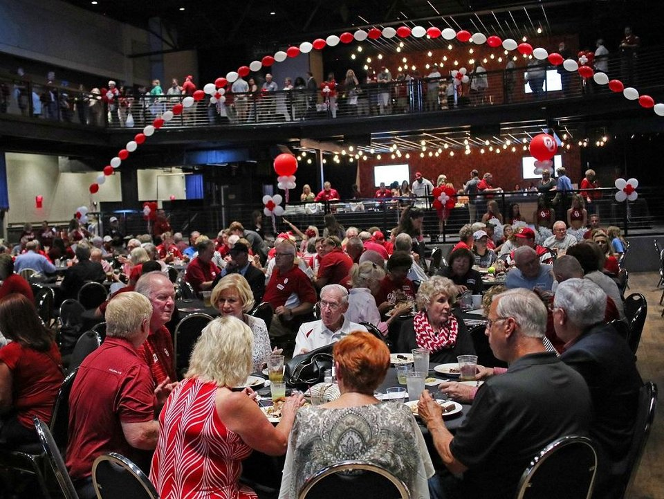 Photo - University of Oklahoma fans eat before the program during the OU Night of Champions Oklahoma City stop at the Bricktown Events Center Friday, August 18, 2017. [Doug Hoke/The Oklahoman Archives]