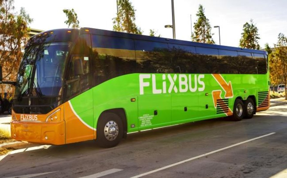 Photo -  A FlixBus is displayed Wednesday during an announcement ceremony of the new transit option for Oklahoma City at the Santa Fe Depot.  FlixBus is an international bus company that doesn't actually own its buses has opened service between Oklahoma City, Tulsa, Stillwater, Dallas and Houston.  [Chris Landsberger/The Oklahoman]