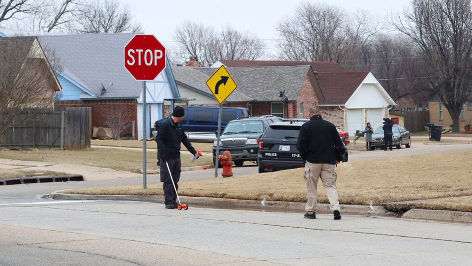 Photo - Officers investigate the scene on Main Street where Moore High School students  were run over by a pickup truck Monday, killing two, on Tuesday, February 4, 2020.  [Photo by Doug Hoke/The Oklahoman]