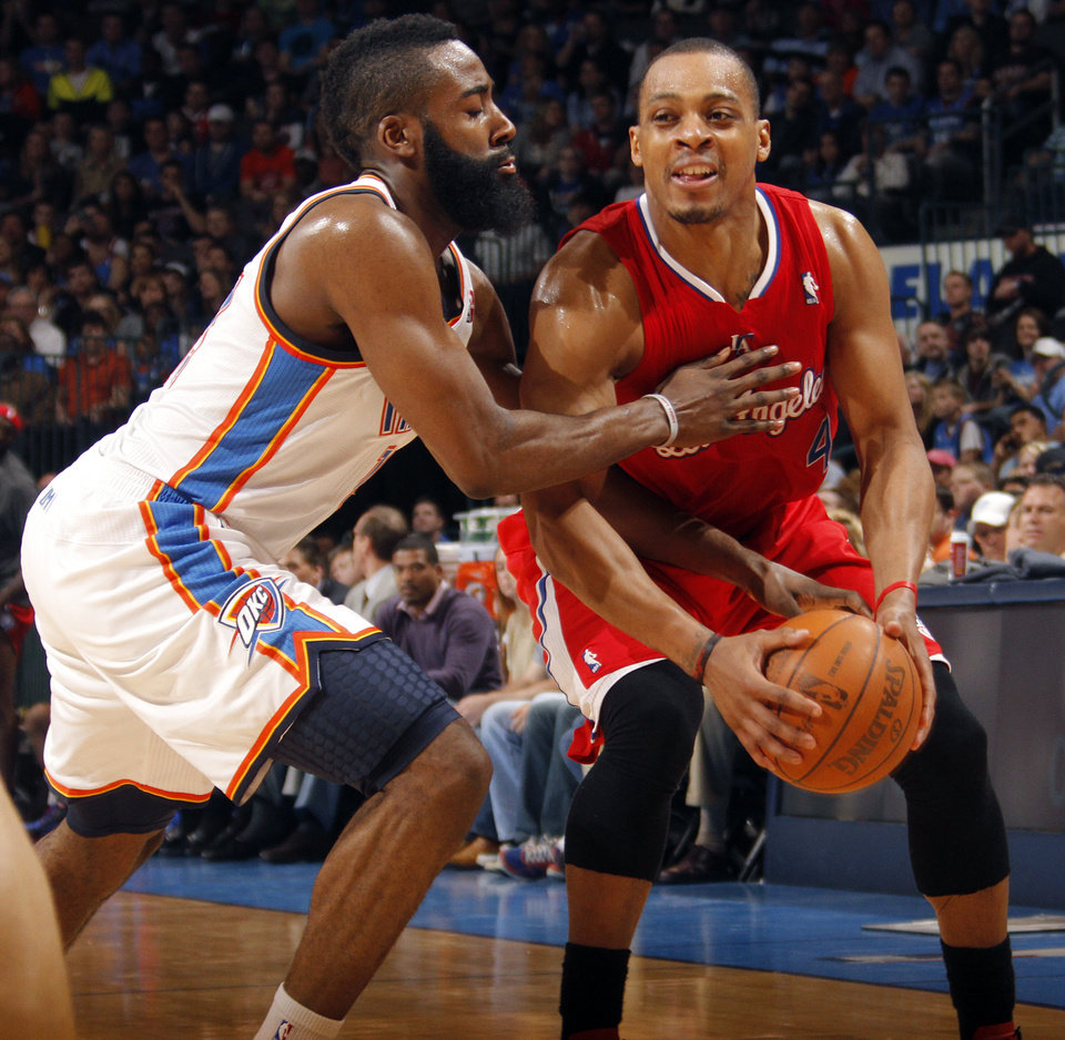 Photo - Oklahoma City Thunder guard James Harden (13) defends on Los Angeles Clippers guard Randy Foye (4) during the NBA basketball game between the Oklahoma City Thunder and the Los Angeles Clippers at Chesapeake Energy Arena on Wednesday, March 21, 2012 in Oklahoma City, Okla.  Photo by Chris Landsberger, The Oklahoman