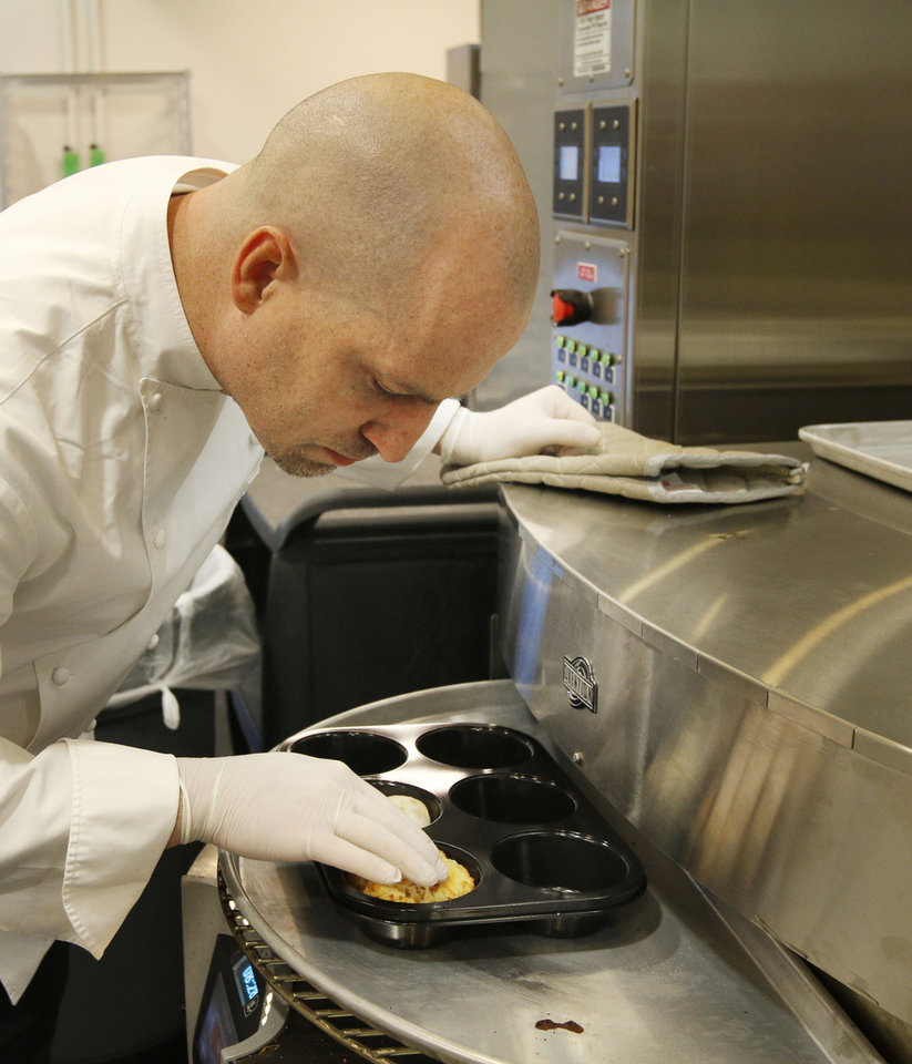 Photo - Chef Brian McKinney tests a bread product at Sonic Drive In's new test kitchen.  PAUL HELLSTERN -  Oklahoman
