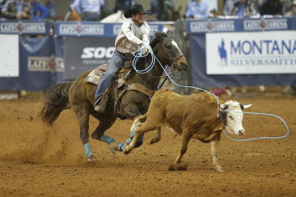 Photo - Paul D. Tierney of Oklahoma City competes in the heading event during the Timed Event Championship inside the Lazy E Arena in Guthrie, Okla., Friday, March 13, 2020. [Bryan Terry/The Oklahoman]