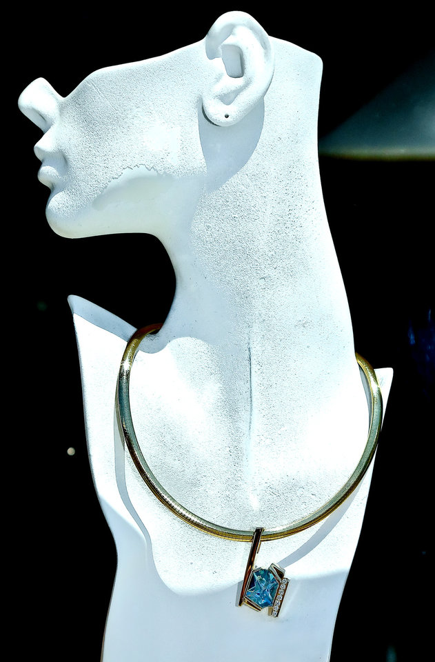 Photo -  Jewelry by artist Johnathan Stopper, of Sarasota, Fla., on display during the Oklahoma City Festival of the Arts in Oklahoma City, Okla. on Tuesday, April 21, 2015. Photo by Chris Landsberger, The Oklahoman   CHRIS LANDSBERGER -  CHRIS LANDSBERGER