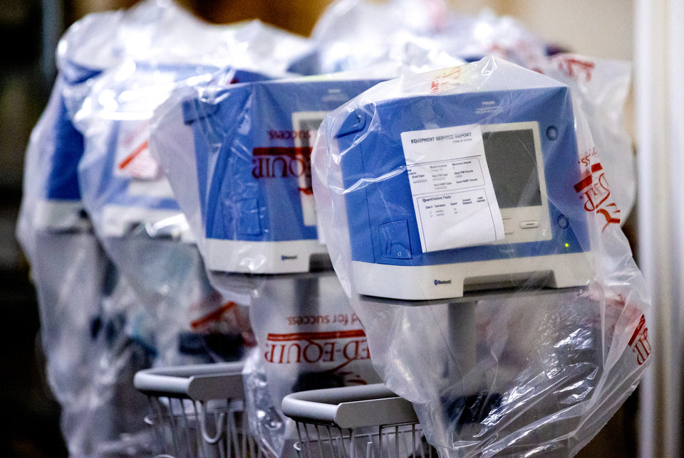 Photo - Boxes of personal protection equipment (PPE) and medical supplies in Oklahoma City, Okla. on Tuesday, April 7, 2020 in a warehouse where the State of Oklahoma has amassed a stockpile for its COVID-19 response.   [Chris Landsberger/The Oklahoman]