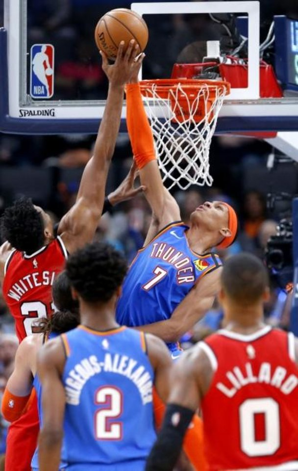 Photo -  Oklahoma City's Darius Bazley (7) blocks the shot of Portland's Hassan Whiteside (21) during the Thunder's 119-106 win Saturday. [Sarah Phipps/The Oklahoman]
