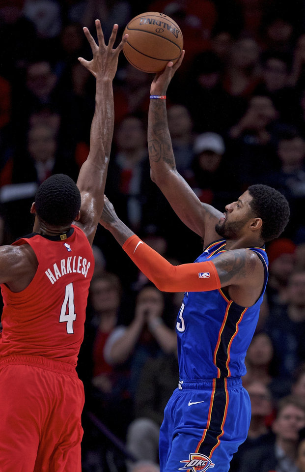 Photo - Oklahoma City Thunder forward Paul George, right, shoots over Portland Trail Blazers forward Maurice Harkless during the second half of an NBA basketball game in Portland, Ore., Friday, Jan. 4, 2019. The Thunder won 111-109. (AP Photo/Craig Mitchelldyer)