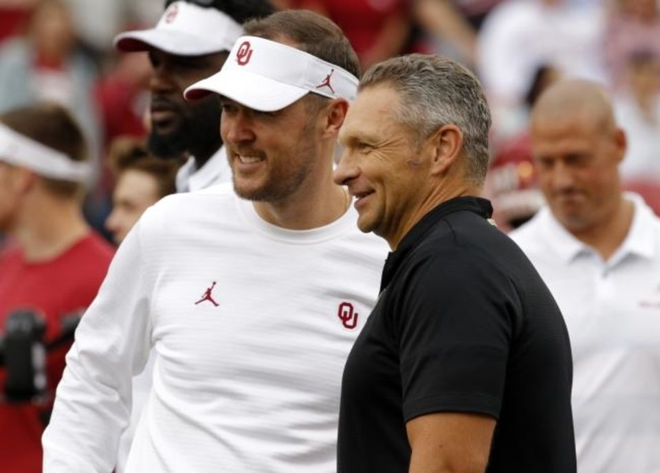 Photo -  OU coach Lincoln Riley talks with Army coach Jeff Monken before last year's epic overtime game in Norman. The Sooners are scheduled to play at Army in 2020. [Steve Sisney/The Oklahoman archives]