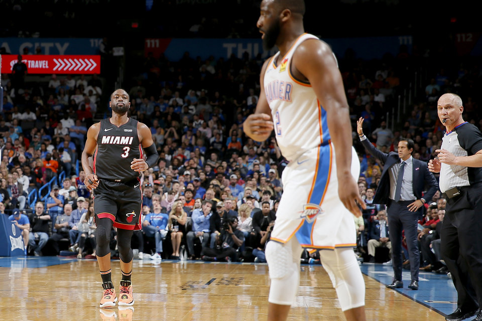 Photo - Miami's Dwyane Wade (3) looks toward Oklahoma City's Raymond Felton (2) after making a 3-pointer during an NBA basketball game between the Oklahoma City Thunder and the Miami Heat at Chesapeake Energy Arena in Oklahoma City, Monday, March 18, 2019. Miami won 116-107. Photo by Bryan Terry, The Oklahoman