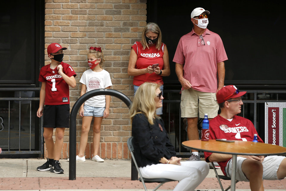Photo - People gather on Camus Corner before a college football game between the University of Oklahoma Sooners (OU) and Missouri State in Norman, Okla., Saturday, Sept. 12, 2020. [Bryan Terry/The Oklahoman]
