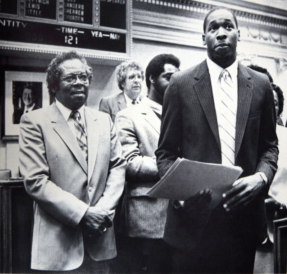 Photo - Former OU basketball player Wayman Tisdale. STATE LEADERS HONOR MR. T - University of Oklahoma basketball star Wayman Tisdale (right) holds a proclamation given to him by the Oklahoma Legislature Wednesday honoring him and the achievements of the Sooner basketball team. Accompanying Tisdale is his father, the Rev. Louis Tisdale (left). AP LaserPhoto. Photo taken, Photo published 4/5/1984, 3/29/1997 in The Daily Oklahoman. ORG XMIT: KOD