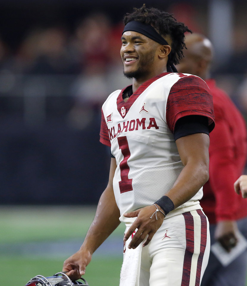 Photo - Oklahoma's Kyler Murray (1) smiles during the Big 12 Championship football game between the Oklahoma Sooners (OU) and the Texas Longhorns (UT) at AT&T Stadium in Arlington, Texas, Saturday, Dec. 1, 2018.  Oklahoma won 39-27. Photo by Bryan Terry, The Oklahoman