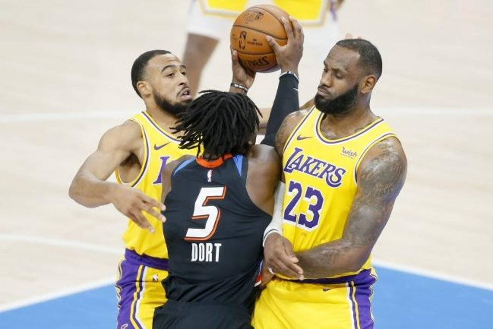 Photo -  Oklahoma City's Luguentz Dort (5) is called for a foul as he runs into Los Angeles' LeBron James (23) and Talen Horton-Tucker (5) during an NBA basketball game between the Oklahoma City Thunder and the Los Angeles Lakers at Chesapeake Energy Arena in Oklahoma City, Wednesday, Jan. 13, 2021. [Bryan Terry/The Oklahoman]