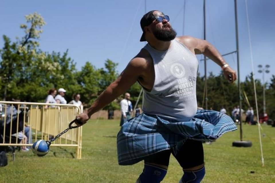 Photo -  Ryan Huddleston, of Yukon, throws in the lightweight for distance competition April 27, 2019, during the Iron Thistle Scottish Festival. [Bryan Terry/The Oklahoman Archives]