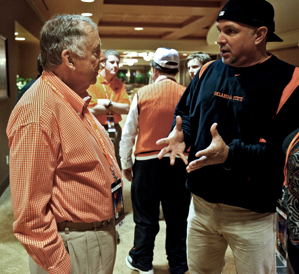 Photo - Boone Pickens talks with country singer Garth Brooks during game day. Photo by Chris Landsberger, The Oklahoman